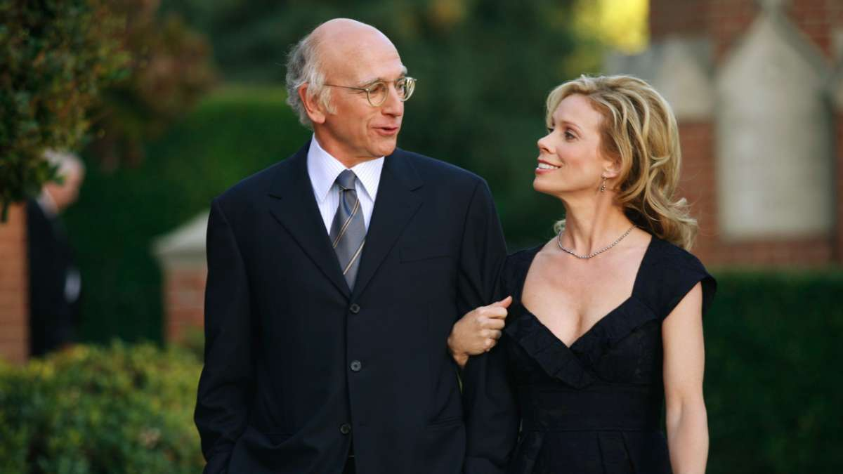 Larry David and Cheryl walking arm in arm