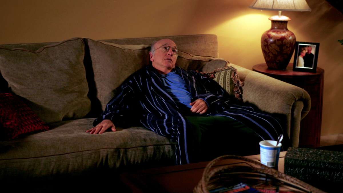 Larry David slumped on couch in robe