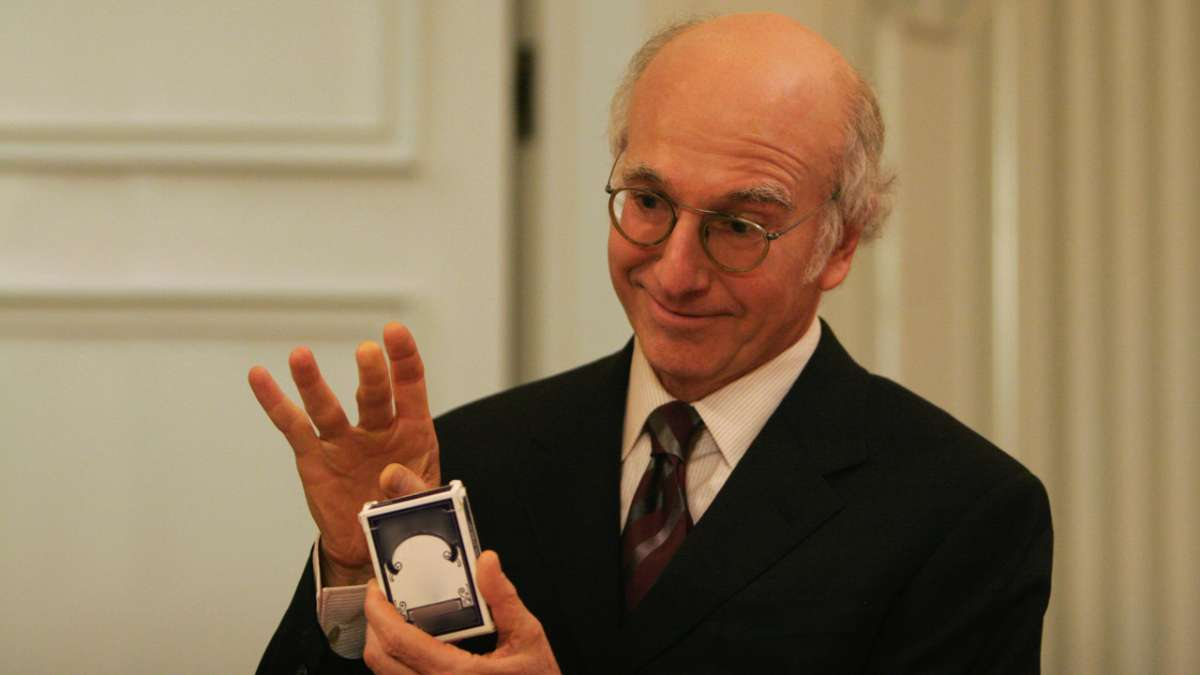 Larry David holding deck of cards